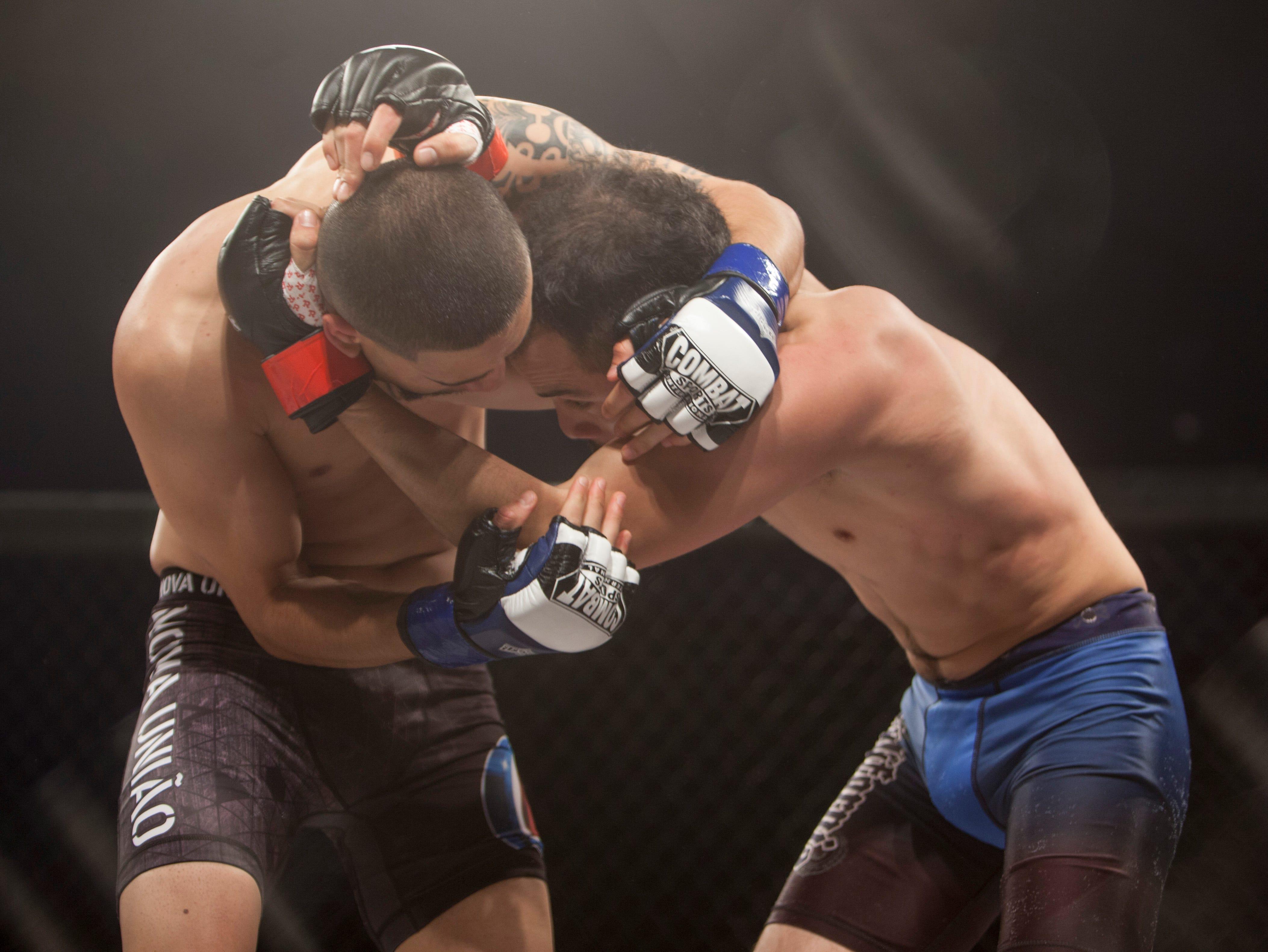 David Lopez, in the red corner, defeats Bronson Sabado during Mayhem in Mesquite at the Casablanca Saturday, Dec. 15, 2018.