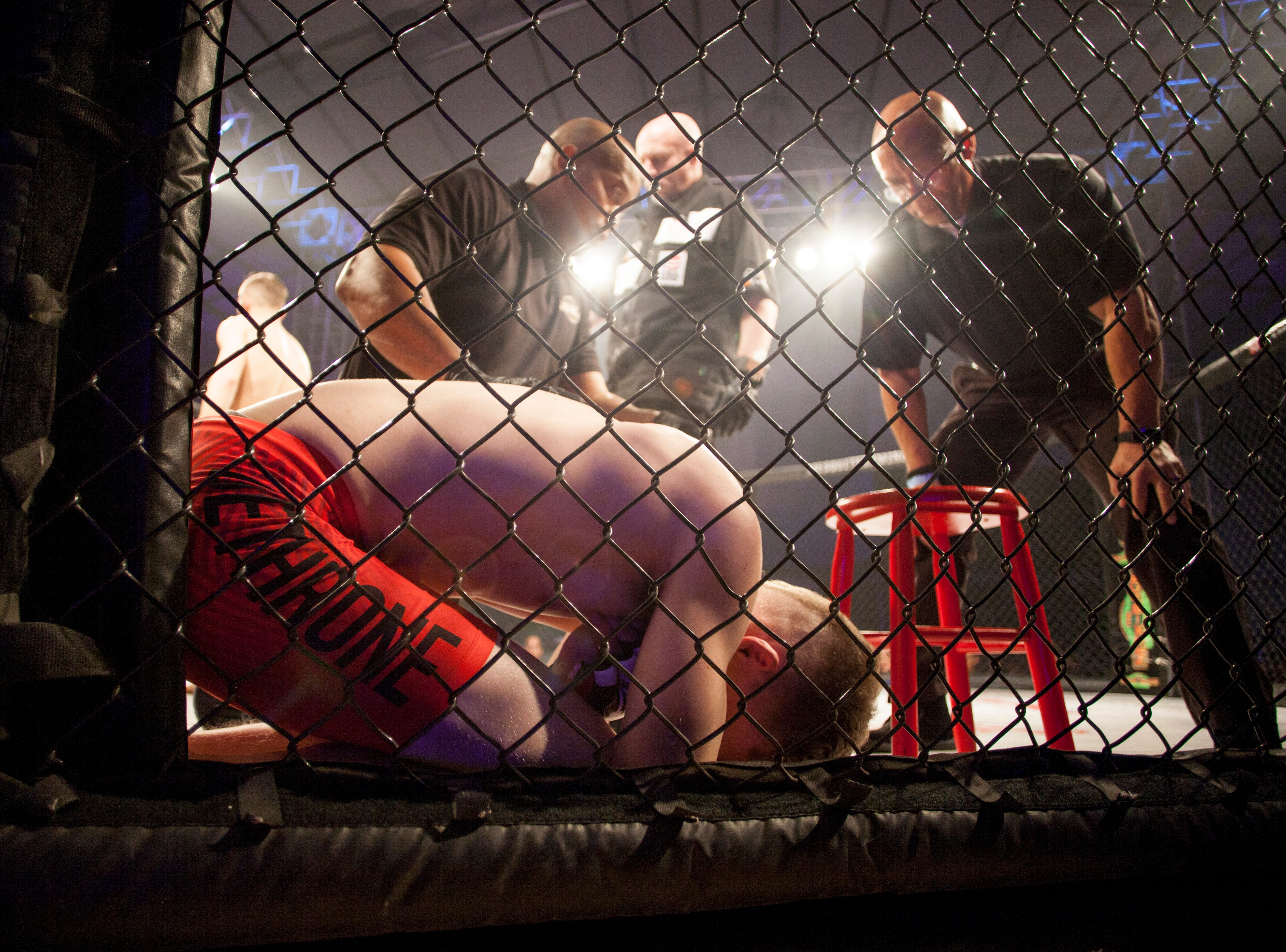 Vance Elrod, in the blue corner, defeats Morgun Colledge during Mayhem in Mesquite at the Casablanca Saturday, Dec. 15, 2018.