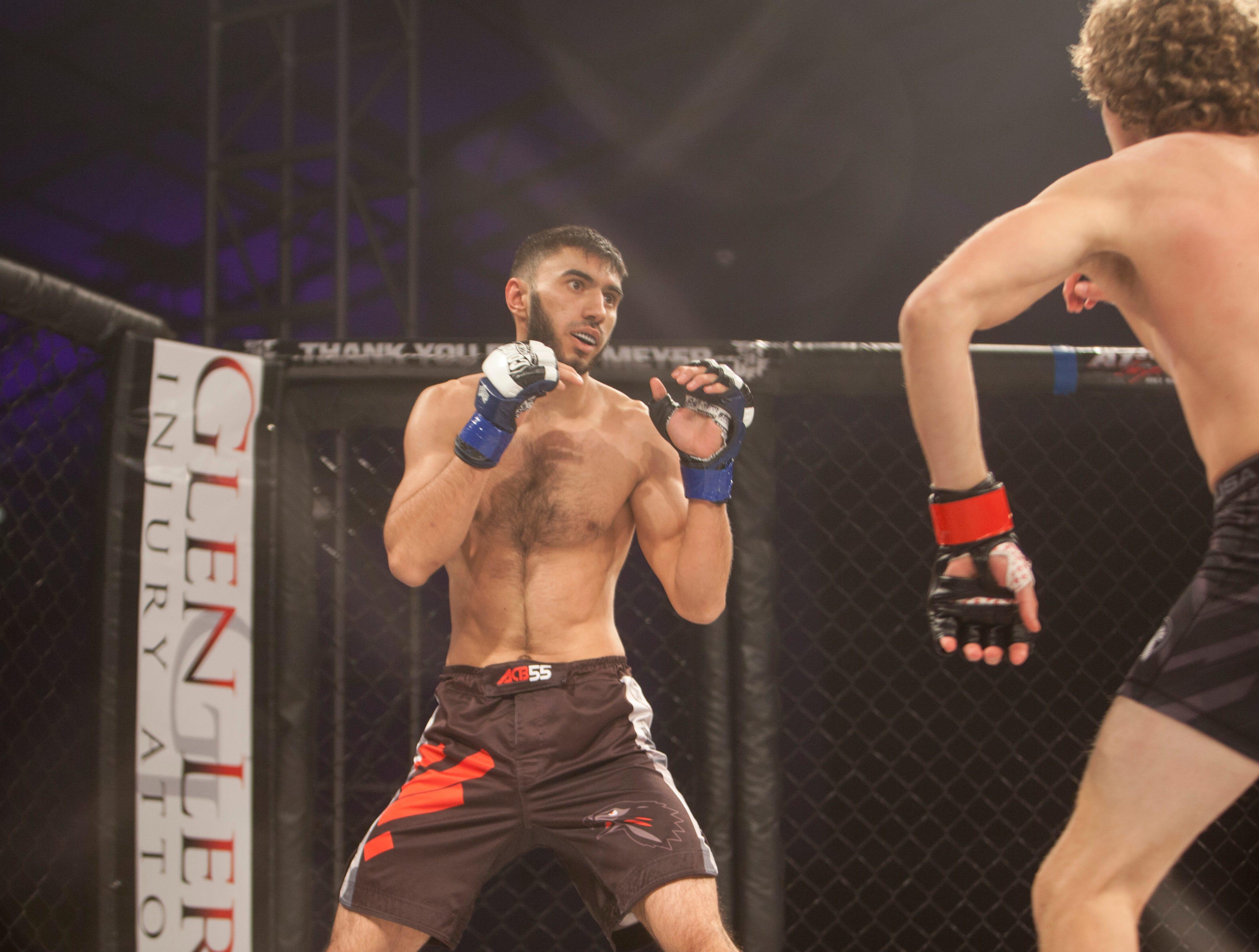 Eraj Aliev, in the blue corner, defeats Hyrum Labaron during Mayhem in Mesquite at the Casablanca Saturday, Dec. 15, 2018.
