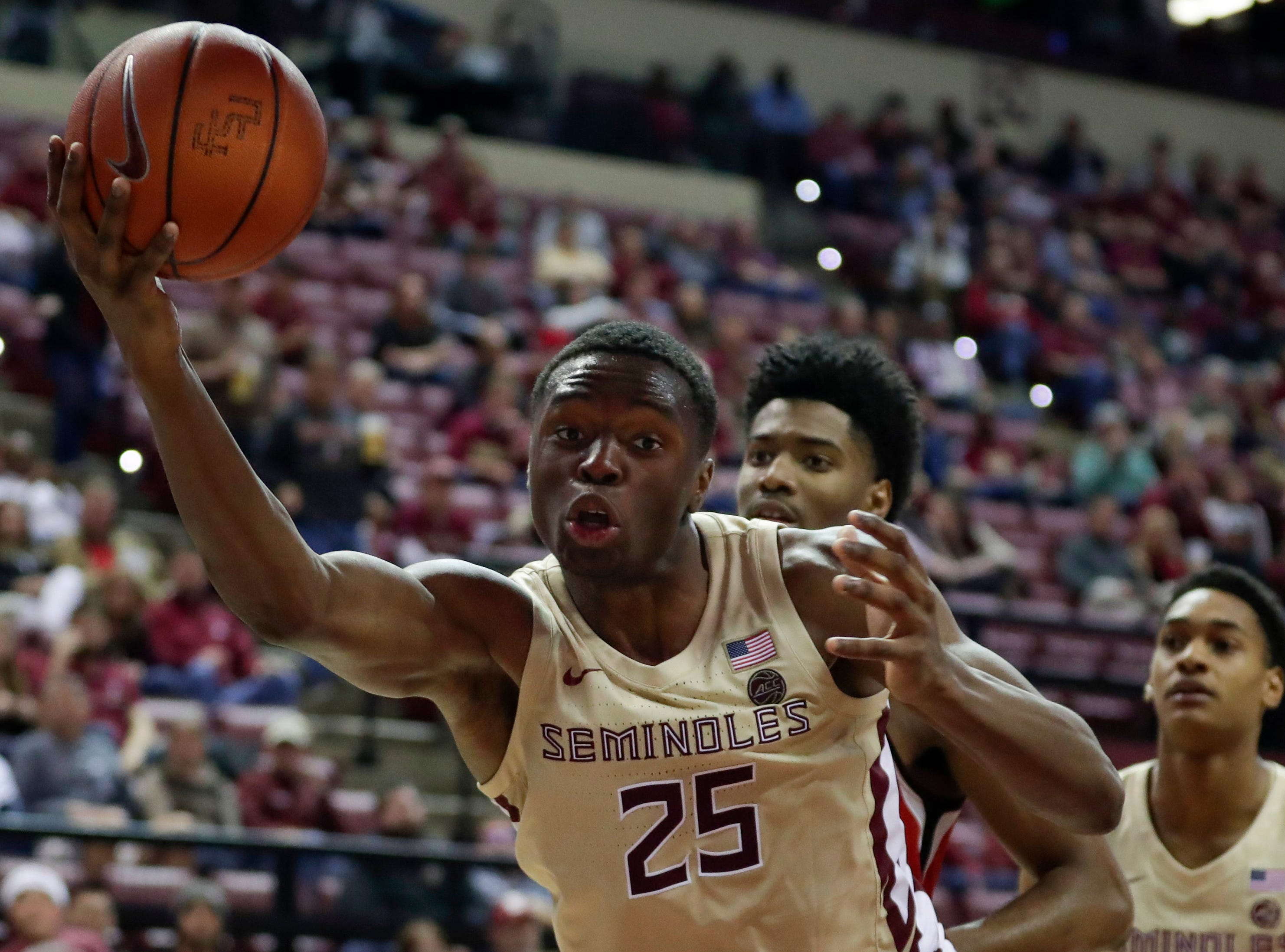 Florida State Seminoles forward Mfiondu Kabengele (25) tries to keep the ball inbounds during a game between Florida State University and Southeast Missouri State University at the Donald L. Tucker Civic Center Monday, Dec. 17, 2018.