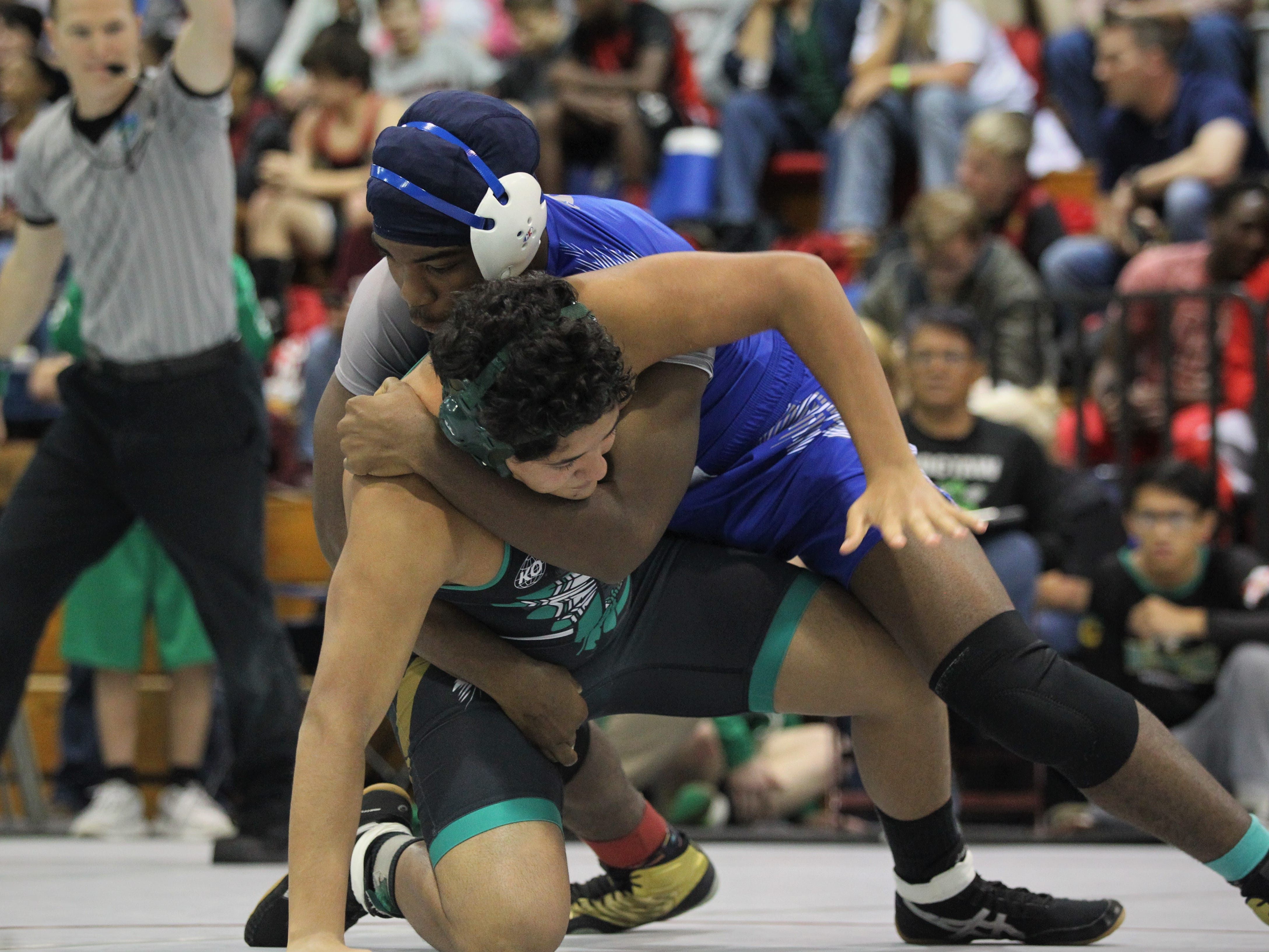 Godby's Julian Green issues a takedown of a Choctaw wrestler during the 2018 Capital City Classic wrestling tournament at Chiles High School.