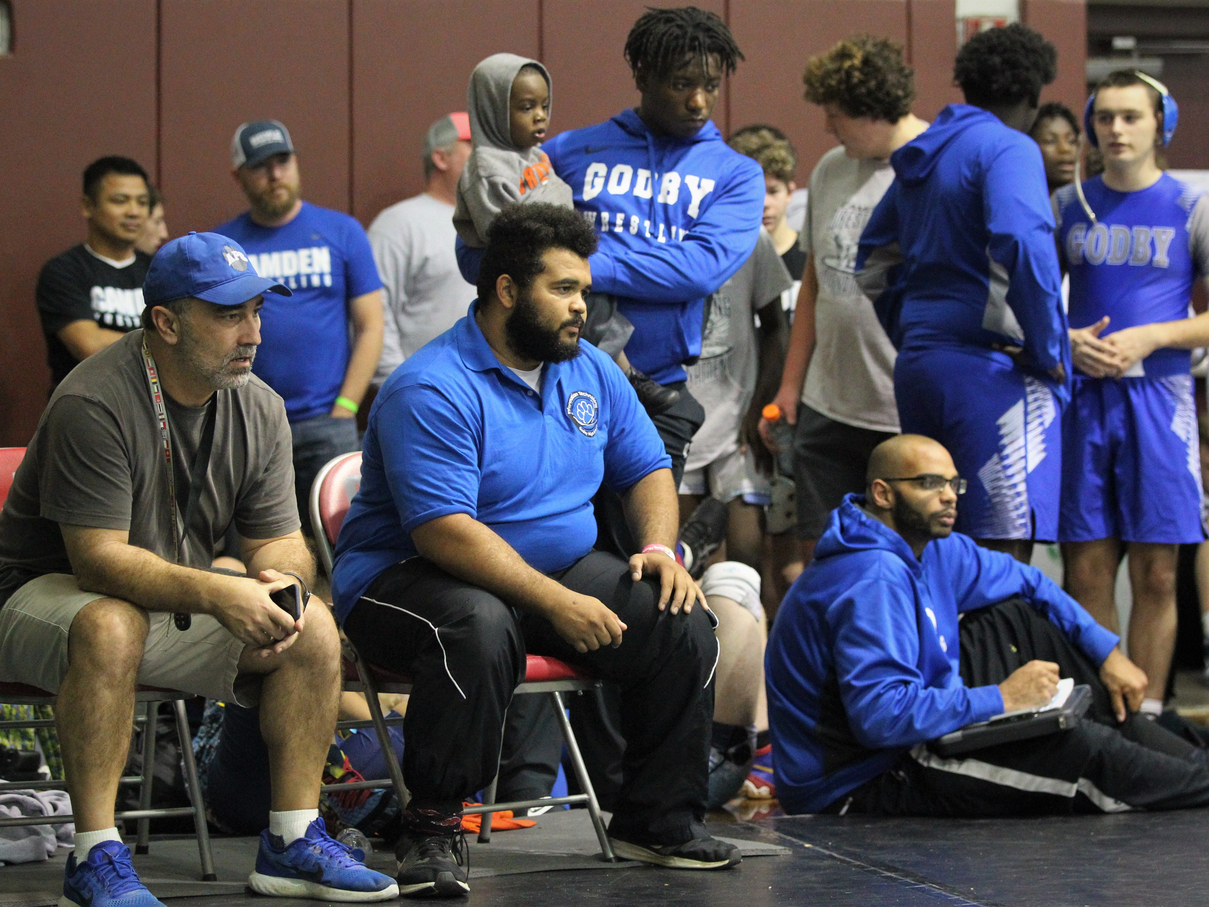 Godby wrestling coach John Wainwright, MaShawn Knight, and Jacob Fahrenkrug watch one of their wrestlers during the 2018 Capital City Classic wrestling tournament at Chiles High School.