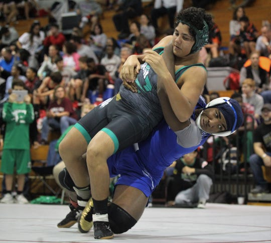 Godby's Julian Green takes down a Choctaw wrestler during the 2018 Capital City Classic wrestling tournament at Chiles High School.