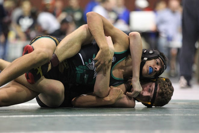 Chiles sophomore Alex Adkins works his way toward a first-round win at the 2018 Capital City Classic wrestling tournament at Chiles High School.