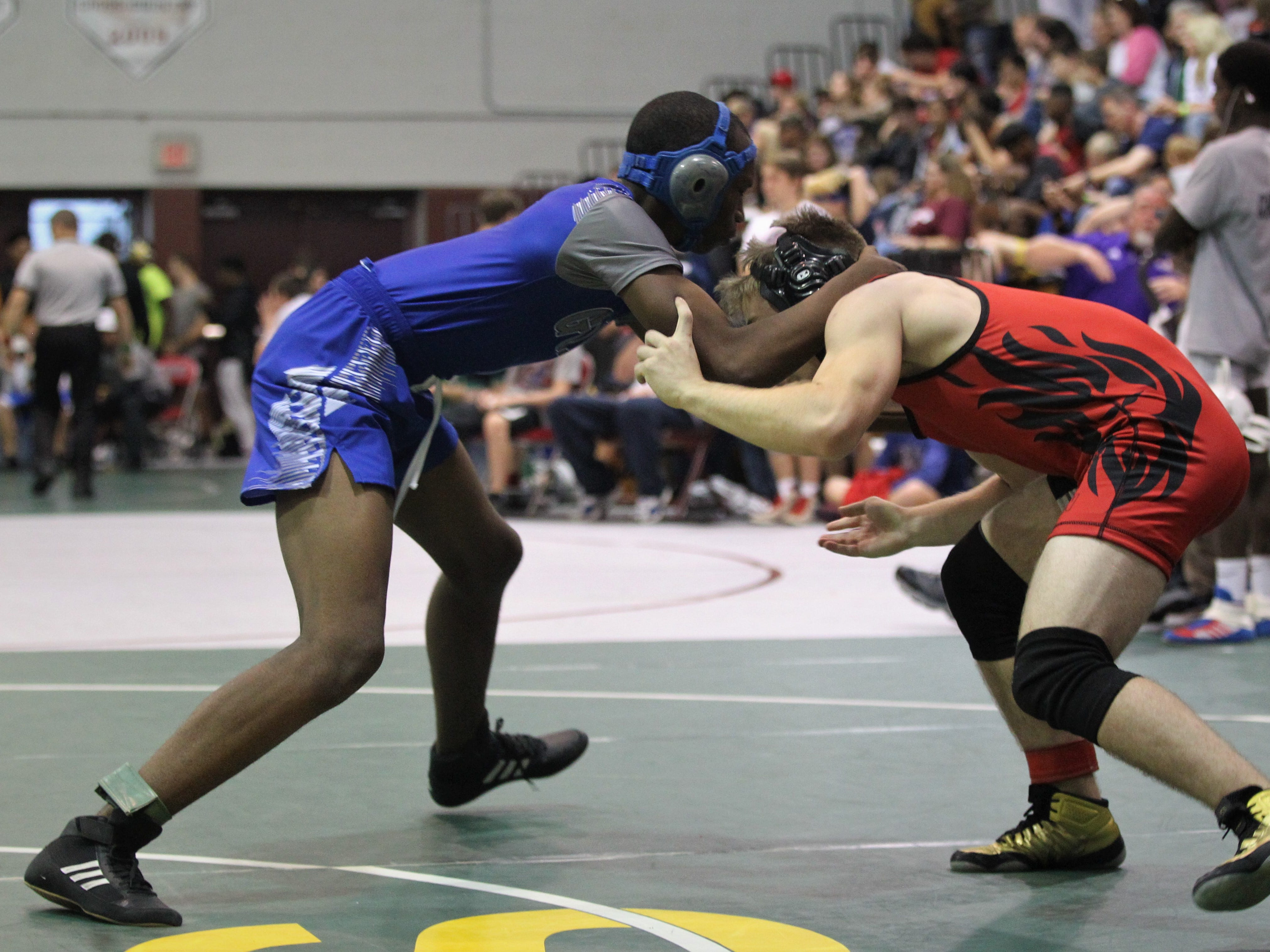 Godby junior Madison Melton wrestles Leon junior Ethan Eudy at 145 pounds during the 2018 Capital City Classic wrestling tournament at Chiles High School.