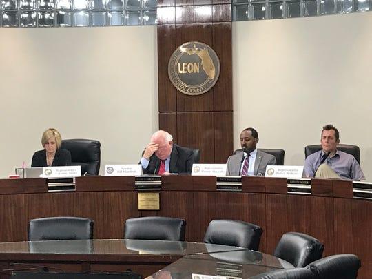 Rep. Loranne Ausley, Sean Bill Montford, Computers Ramon Alexander and Rep. Halsey Beshears, listening to ingredients at the Leon Legislative Delegation meeting