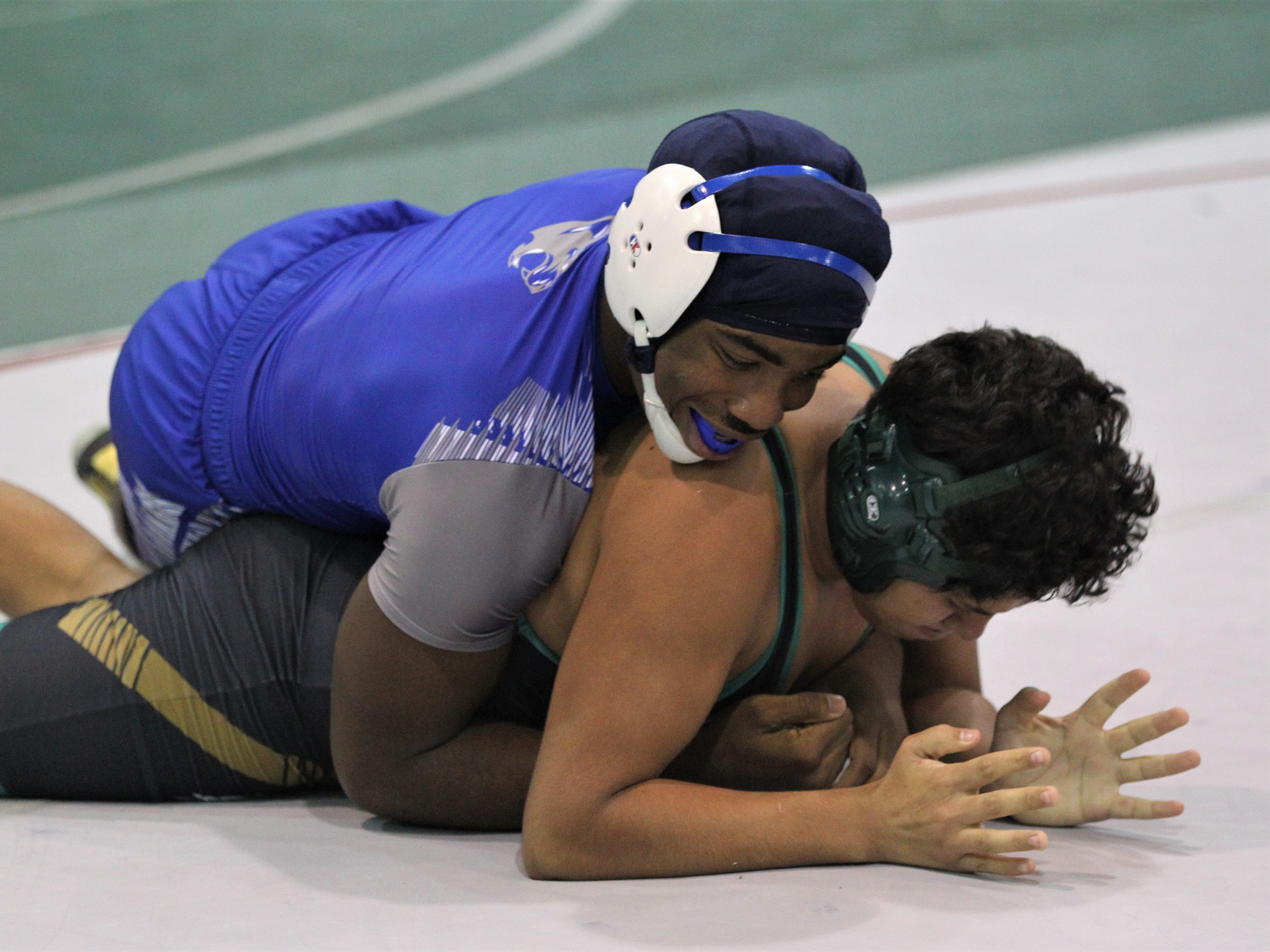 Godby's Julian Green works a Choctaw wrestler during the 2018 Capital City Classic wrestling tournament at Chiles High School.