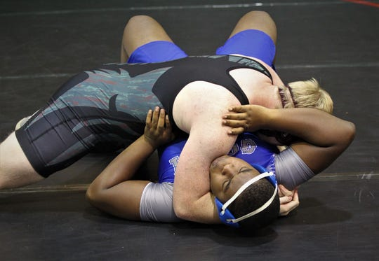 Chiles heavyweight Keith Upthegrove pins Godby's Jamey Murphy during 2018 Capital City Classic wrestling tournament at Chiles High School.
