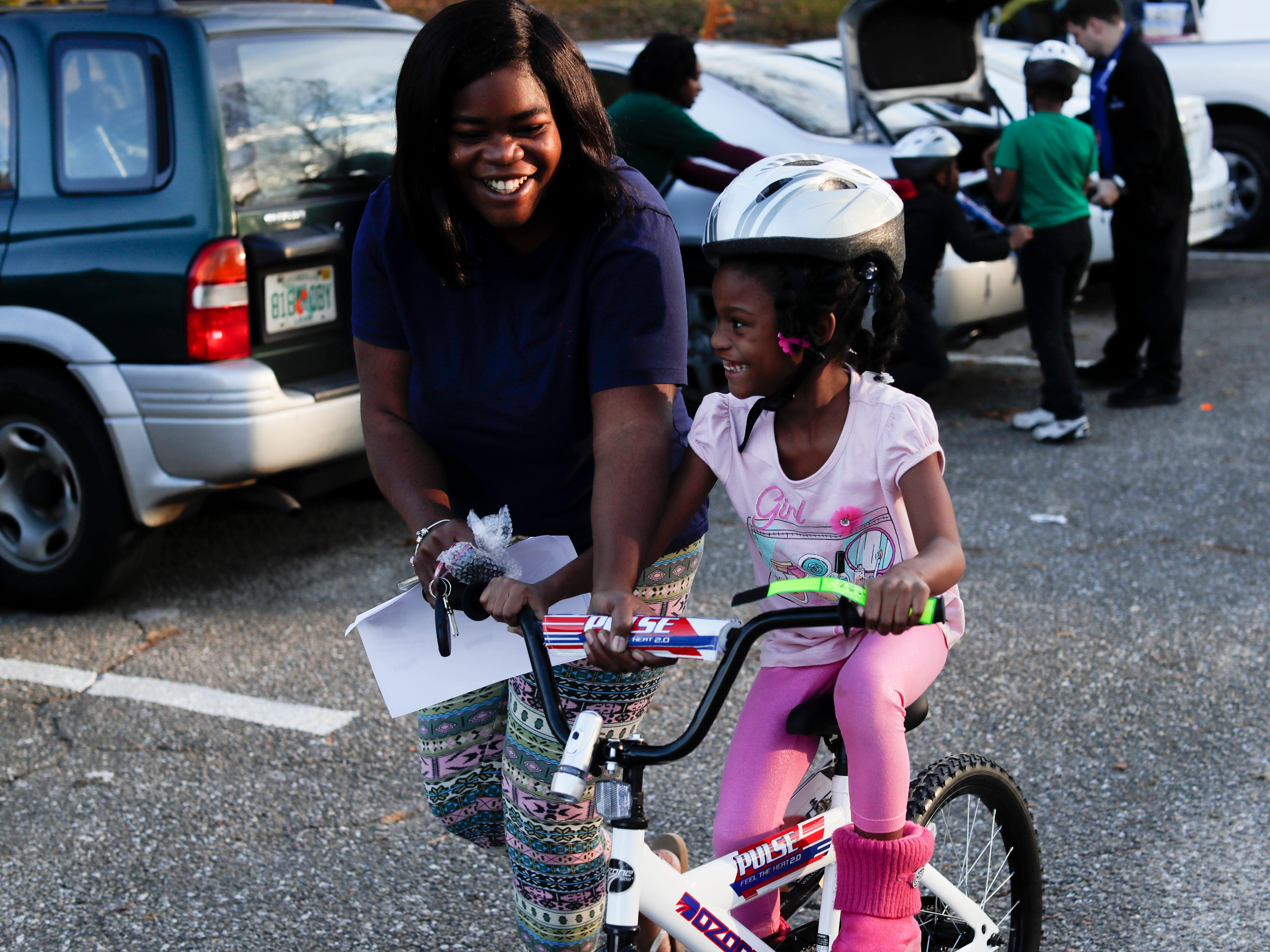 Academy Sports, Tallahassee PD and Leon County EMS give away 30 bikes to Tallahassee kids