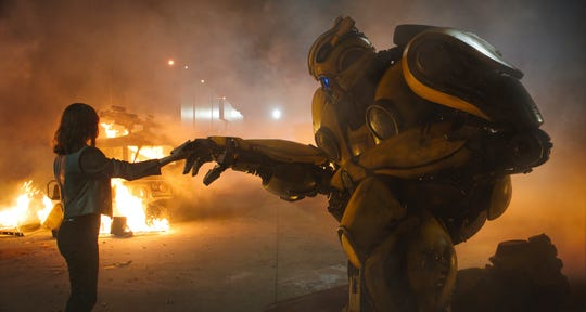 """Hailee Steinfeld as Charlie and Bumblebee in a scene from """"Bumblebee."""""""