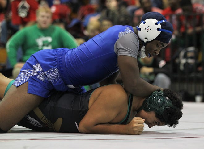 Godby's Julian Green works on a Choctaw wrestler during the 2018 Capital City Classic wrestling tournament at Chiles High School.