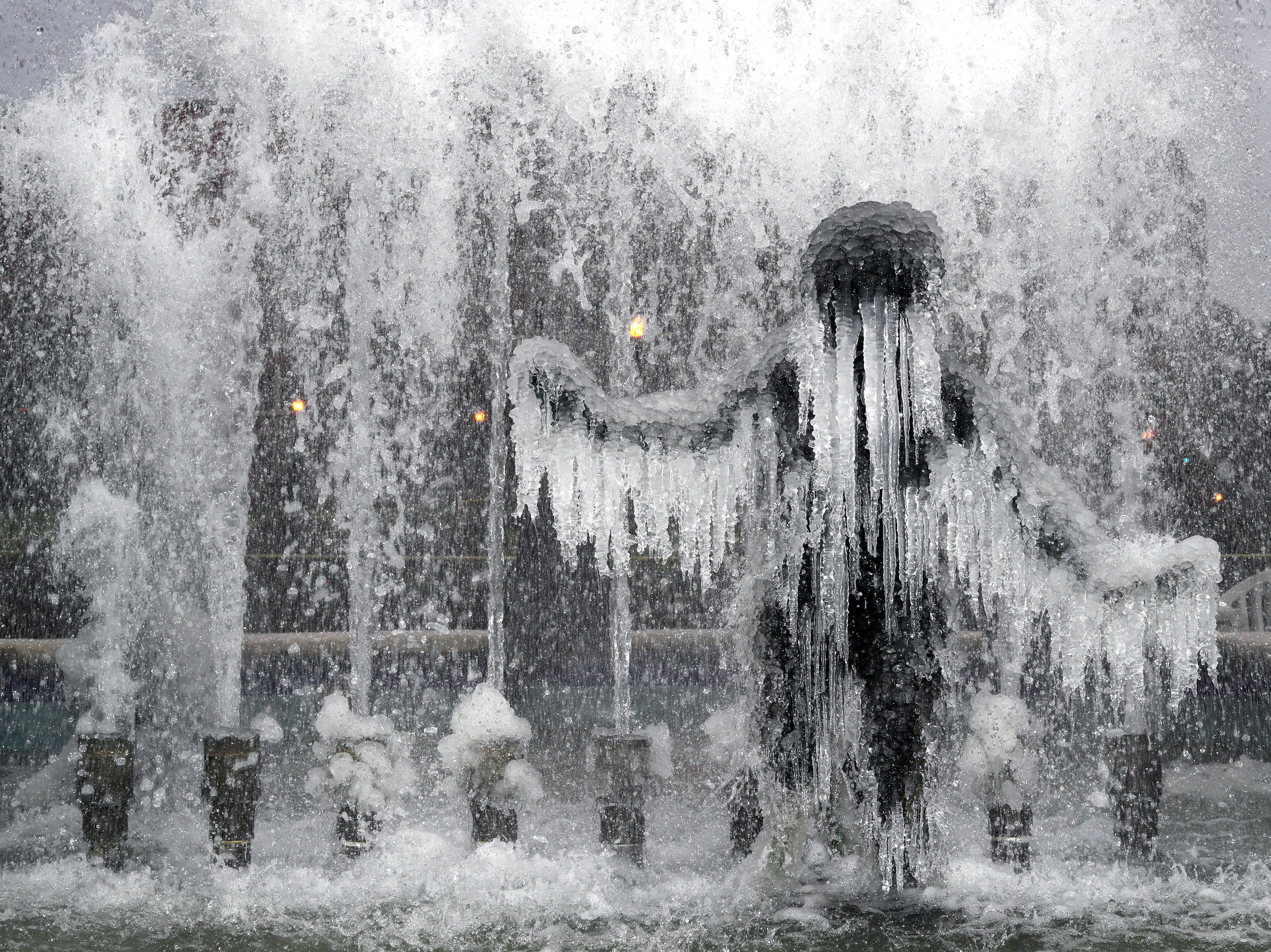 The fountain on Landis Green on Florida State University's campus as a mix of freezing rain, sleet and light snow hits Tallahassee on Wednesday, January 3, 2018.