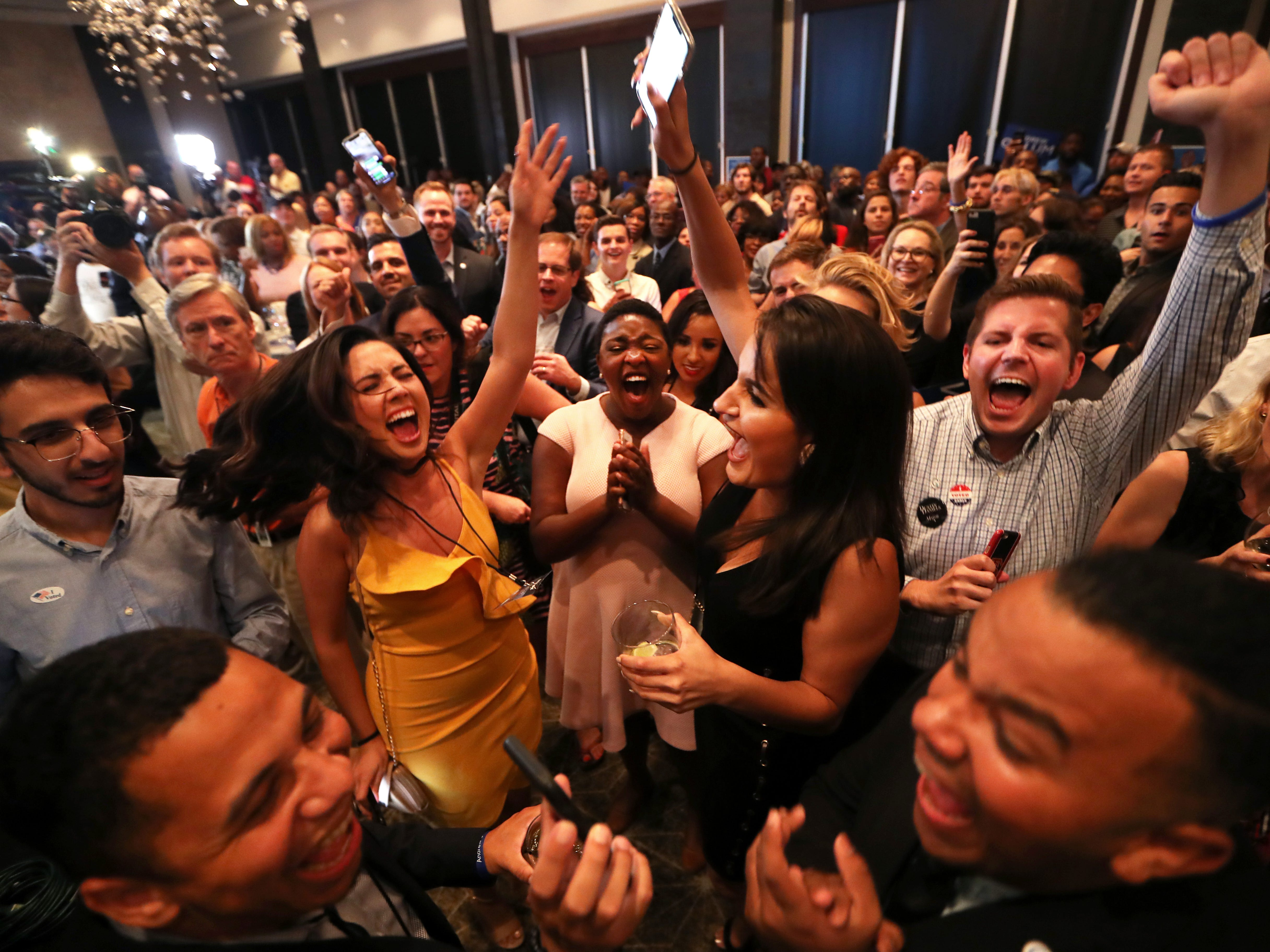 Supporters of democratic gubernatorial nominee Andrew Gillum celebrate his primary victory during his election watch party at Hotel Duval on Tuesday, Aug. 28, 2018.