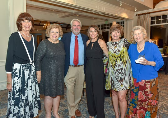 Pat Hoshino, left, Laura DeBerard, Kevin Hutchinson, Bianca Roberton, Carol Baehren-Landeweer and Marlee Matheson at the 2018 Pinot & Picasso event at  Harbour Ridge Yacht & Country Club.