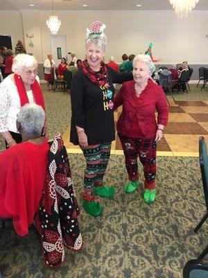 """Mary Metzger, left, with """"elves"""" Deborah Mack and Virginia Rega."""
