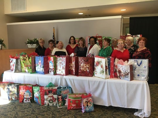 Holy Family Council of Catholic Women members recently collected items for its Back to Basics Angel gift bags for needy childrenin the community.