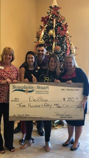 Trilogy Home Health and Symphony of Stuart present Elev8Hope a check  Martin