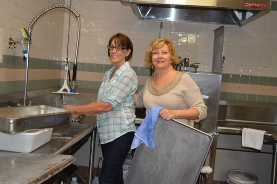 Pat Gustafson, left, and Ellen DeMarrero keep the dishes clean at the 2018 Community Thanksgiving Dinner at Pathway Church in Vero Beach.
