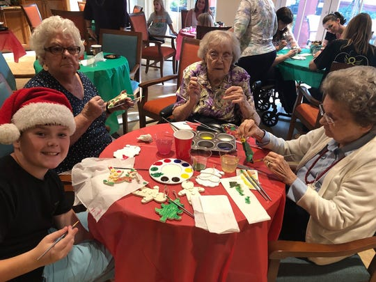 Elev8Hope kids and seniors painted Christmas Tree decorations.