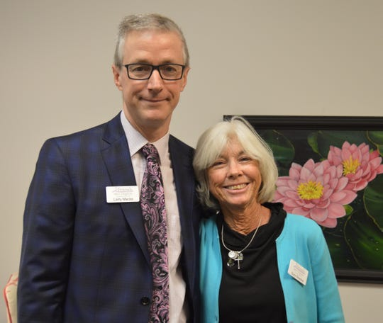 Larry Macke and Suzy Stoeckel at Friendship House, the new home for Friends After Diagnosis, the women's cancer support organization.