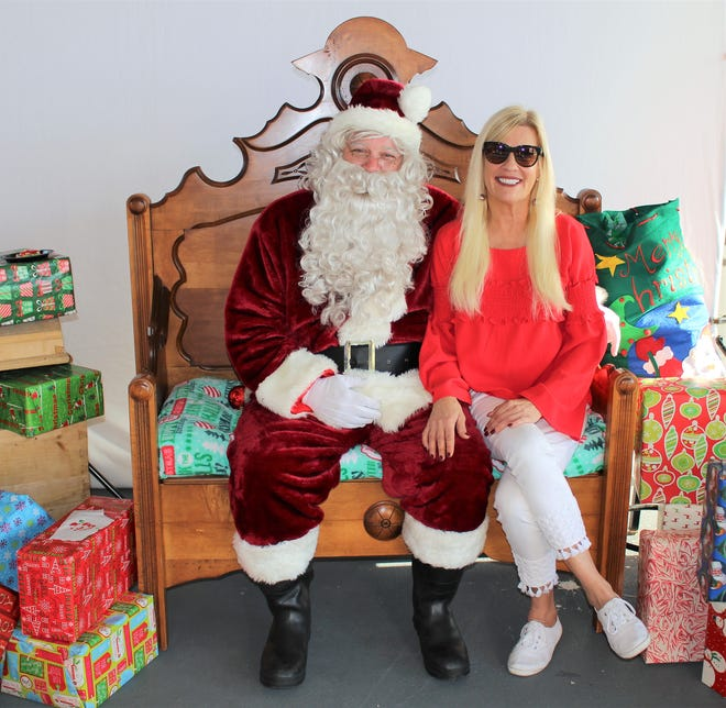 Jodi Harvey visits with Santa at New Horizons of Treasure Coast's 2018 Breakfast with Santa at First Data Field.