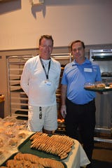 Chris Runge, left, and Chris Horsley oversee the Thanksgiving desserts in the kitchen at Pathway Church, Vero Beach.