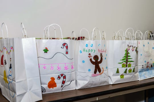 """The """"Be a Santa to a Senior"""" gift bags were decorated by third-grade students at St. Lucie West K-8 School."""