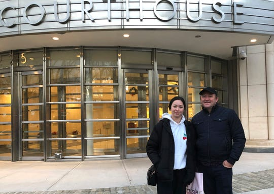 """In this Dec. 3, 2018, photo, Australian tourists Wayne Burg and his daughter, Lydia, stand in front of Brooklyn's federal courthouse in New York, where they were viewing the trial of Mexican drug trafficker Joaquin """"El Chapo"""" Guzman. Burg is a criminal lawyer in his home country and said he did not want to miss the chance to witness one day in the trial of """"El Chapo."""""""