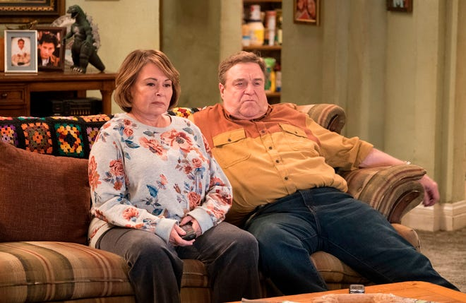 """In this image released by ABC, Roseanne Barr, left, and John Goodman appear in a scene from the comedy series """"Roseanne."""" The comedy about the blue-collar Conner family and its brassy matriarch returned in March as a success for ABC and Roseanne Barr but was canceled in May after Barr's racist slam of President Barack Obama's adviser Valerie Jarrett. ABC called her tweet """"abhorrent."""""""