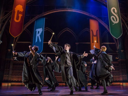 "This image released by Boneau/Bryan-Brown shows a scene from the production of ""Harry Potter and the Cursed Child"" in New York. The two parts of the production are more than a combined five hours."