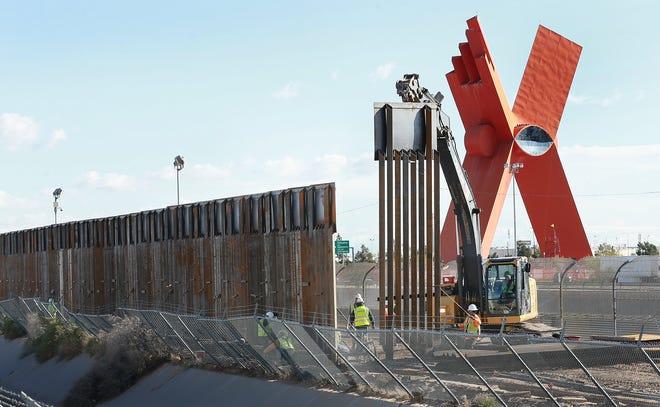 Border fence construction along the César Chávez Border Highway.