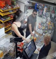 Surveillance footage of the suspect, Gustavo Garcia, robbing a mini mart in Exeter on Sunday.