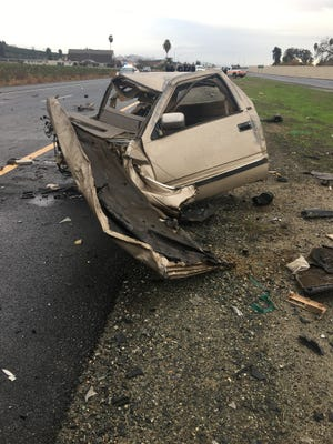 The carjacked vehicle the suspect was driving the wrong way on Highway 65 is seen here after it collided with multiple vehicles.