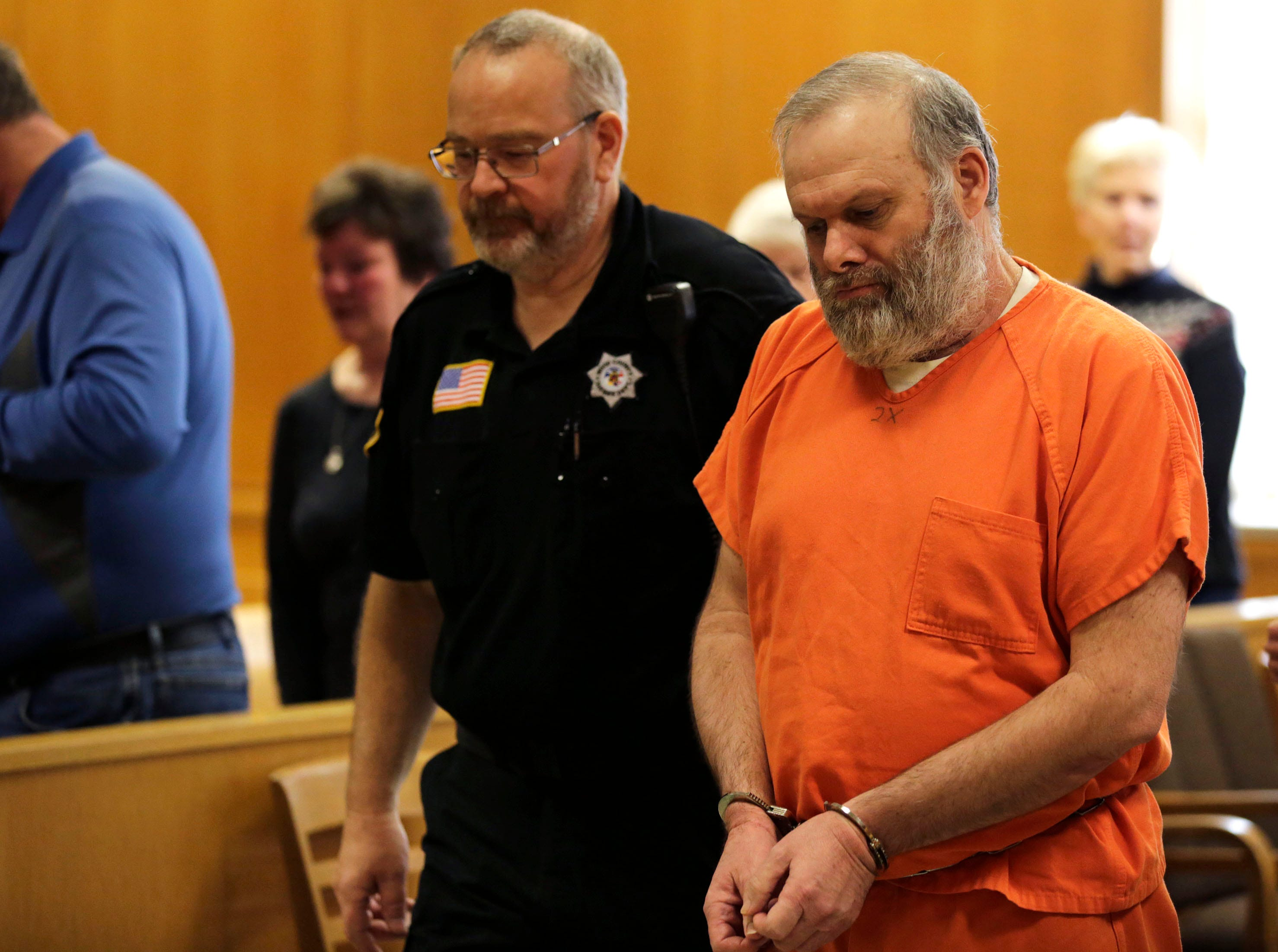 Defendant Gary Bohman is escorted from the courtroom after a sentencing hearing on Tuesday, December 18, 2018, at the Wood County courthouse in Wisconsin Rapids, Wis. Bohman was sentenced to life in prison with no possibility of parole for the murder of Christopher Race.Tork Mason/USA TODAY NETWORK-Wisconsin