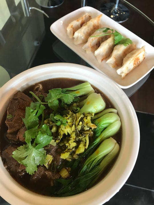 Fried dumplings and braised beef noodle soup at Mister Chen's in Mamaroneck. Photographed Nov. 2018.