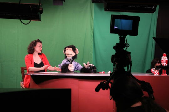 Host Tamra Malaga and co-host Gordon Goodall handled by puppeteer Josh Cohen, on the set of the Monkey News Source television show in White Plains, Dec. 18, 2018.