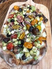 Avocado pizza at TVB by: Pax Romana in White Plains.