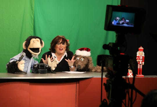 Co-host Gordon Goodall handled by puppeteer Josh Cohen, guest comedian Katina Corrao and Ruffus, handled by guest puppeteer Noel MacNeal, on the set of the Monkey News Source television show in White Plains, Dec. 18, 2018.