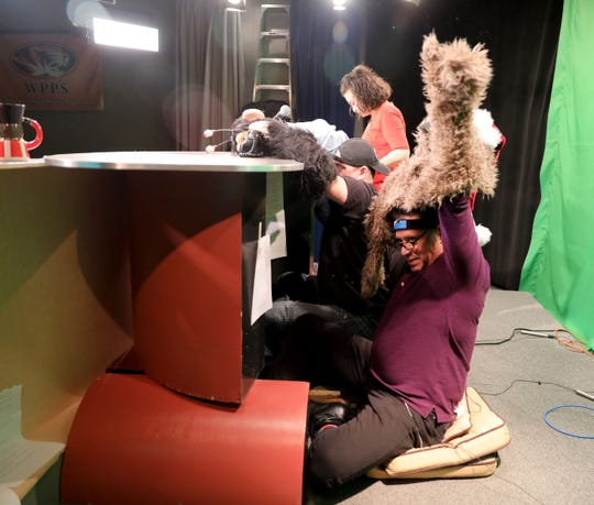 Guest puppeteer Noel MacNeal handles Ruffus from behind the desk, on the set of the Monkey News Source television show in White Plains, Dec. 18, 2018.