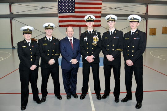 On Tuesday, Dec. 18, 2018, Senator Chris Coons visited with two of his principal nominees for service academy appointments. Collin Green, center right, of the Delaware Military Academy is the principal nominee for the United States Naval Academy. He is pictured here with four other DMA graduates currently attending the Naval Academy.