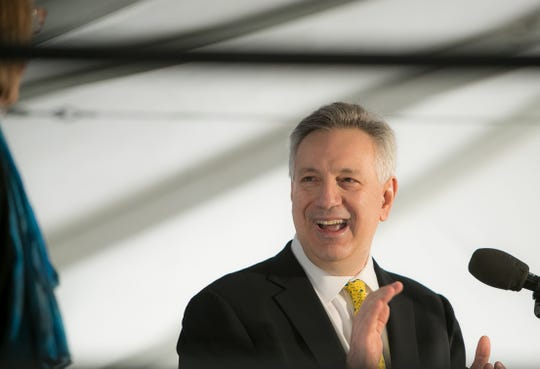 Dennis Assanis, president of the University of Delaware, announces the start of a $60 million renovation of Delaware Stadium and the creation of the Whitney Athletic Center during a groundbreaking ceremony in December.