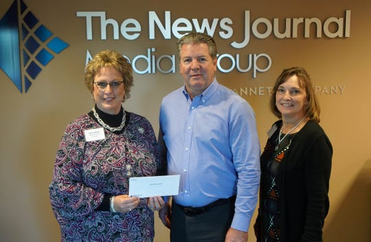Nanticoke Health Foundation receives a check from News Journal publisher Tom Donovan.
