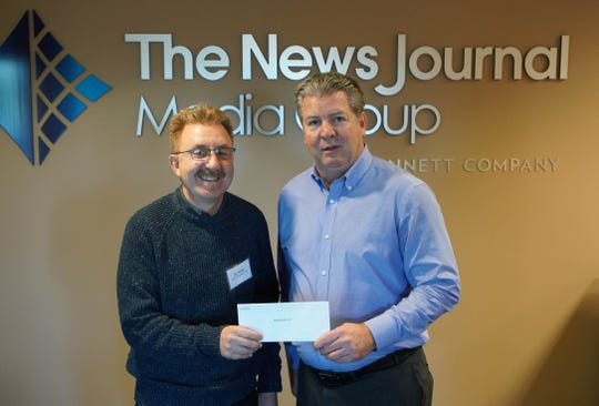 John Hornor with Hope Dining Room receives a check from News Journal publisher Tom Donovan.