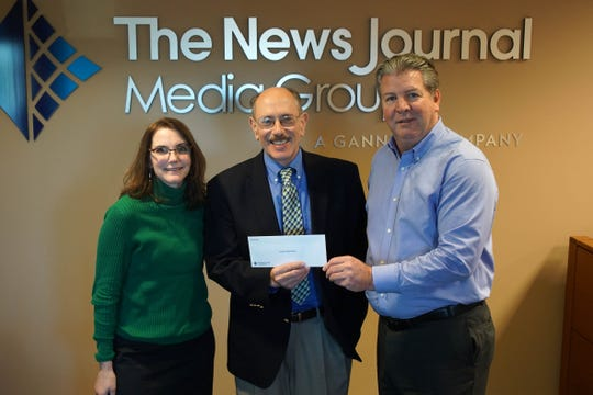 Sunday Breakfast Mission receives a check from News Journal publisher Tom Donovan.
