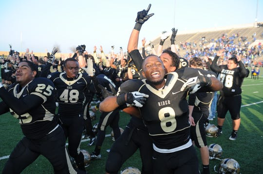 Rider's Domanic Thrasher (8) reacts after the Raiders defeated Frenship during the Region I-4A Finals at Memorial Stadium on Dec. 8, 2012.