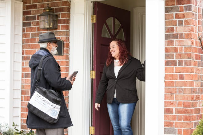 In this 2018 photo, a U.S. Census worker visits with a resident in Providence, RI, during a simulated non-response follow-up interview. In-person operations of the Bureau have adapted to comply with health measures due to COVID-19 while continuing the important business of getting an accurate population count. The Bureau's count occurs every 10 years as required by federal law.