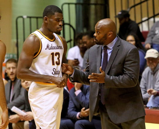 Midwestern State head basketball coach Nelson Haggerty talks with D'monta Harris in the game against Mid-America Christian Monday, Dec. 17, 2018, at D.L. Ligon Coliseum. The Evangels defeated the Mustags 84-79.