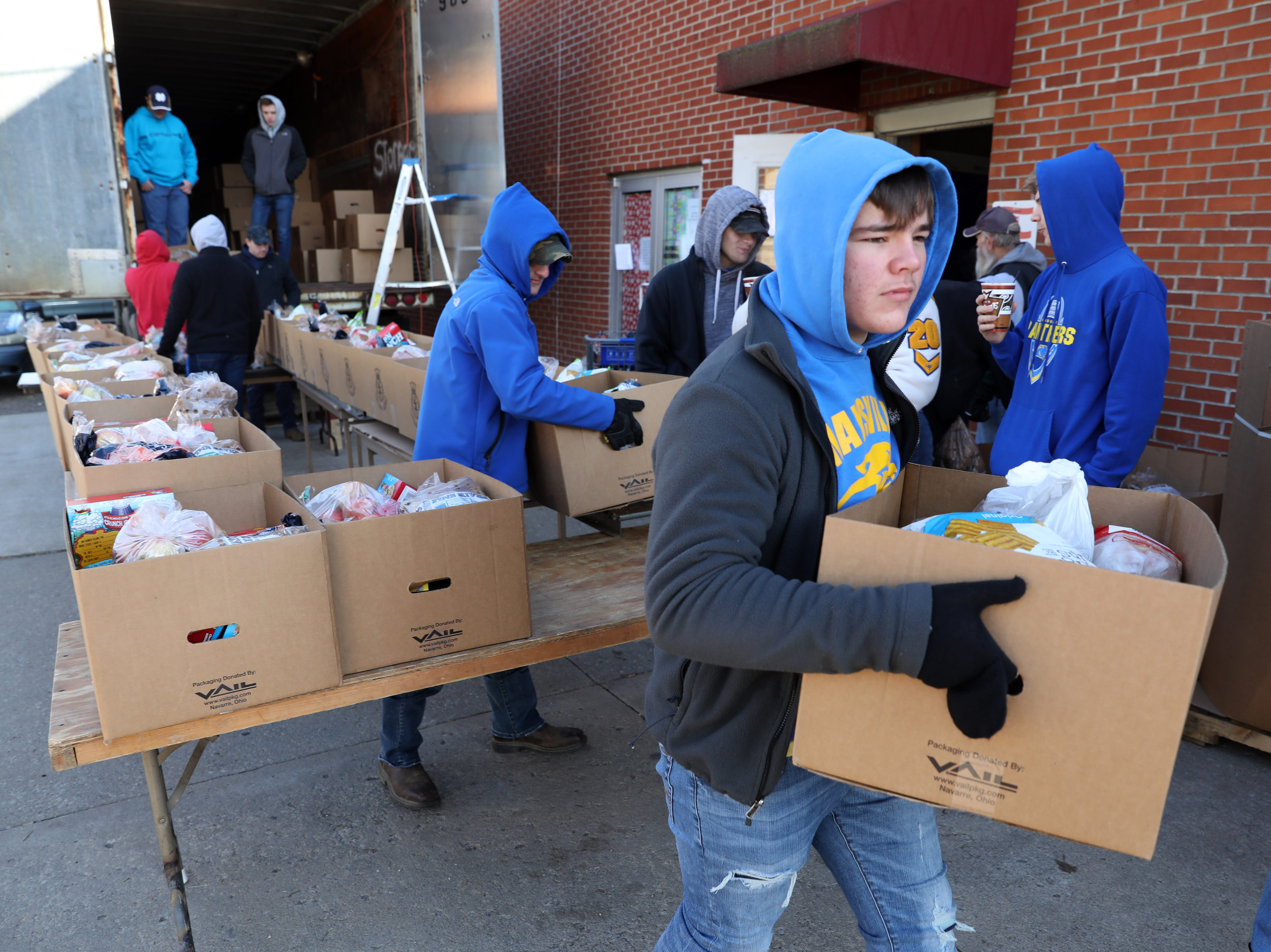 Maysville High School football players volunteered at the Salvation Army for it's annual food and present disbursement on Tuesday.