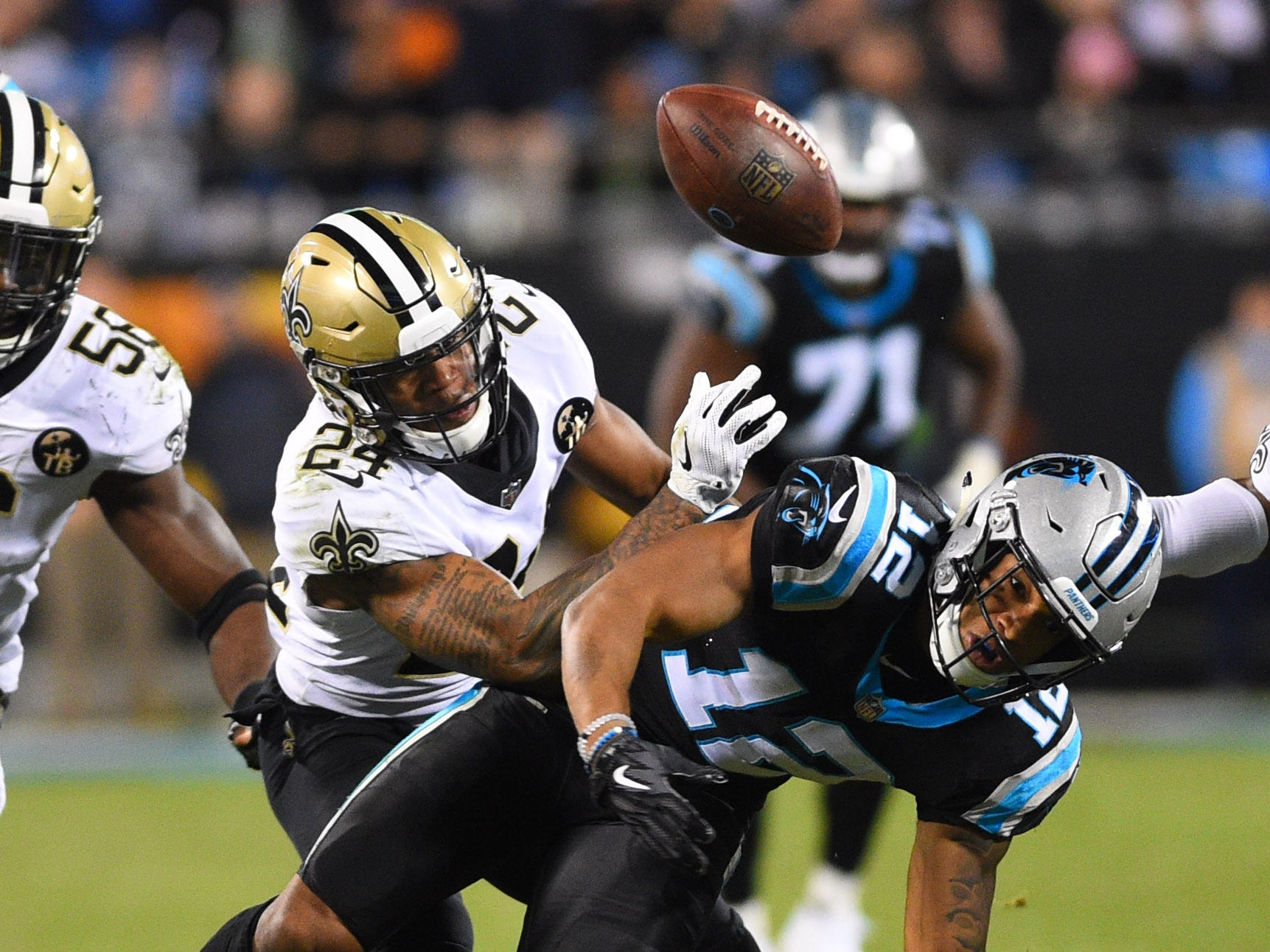 New Orleans Saints strong safety Vonn Bell (24) forces a fumble by Carolina Panthers wide receiver D.J. Moore (12) in the third quarter at Bank of America Stadium.
