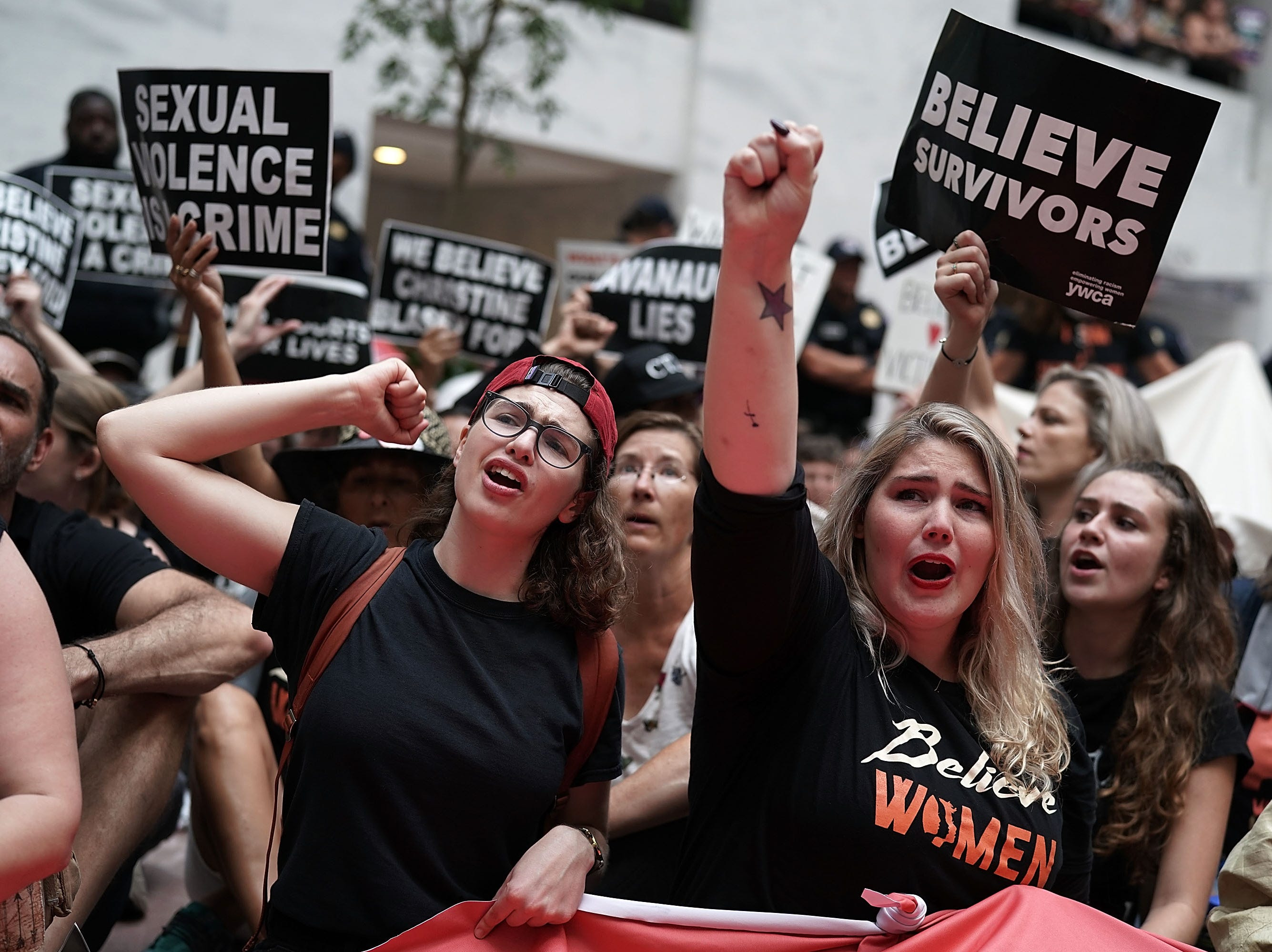 Activists shout slogans during a protest on Oct, 4, 2018 at the Hart Senate Office Building on Capitol Hill in Washington, DC. Activists are rallying in protest against Supreme Court associate justice nominee Brett Kavanaugh.